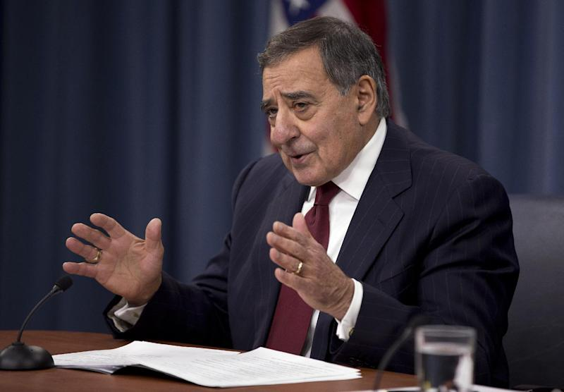 Defense Secretary Leon Panetta gestures during a news conference at the Pentagon, Thursday, Jan. 10, 2013. Panetta said he is asking his department to begin taking steps to freeze civilian hiring, delay some contract awards and curtail some maintenance to prepare for drastic budget cuts if Congress can't reach an agreement on a final spending plan.  (AP Photo/ Evan Vucci)