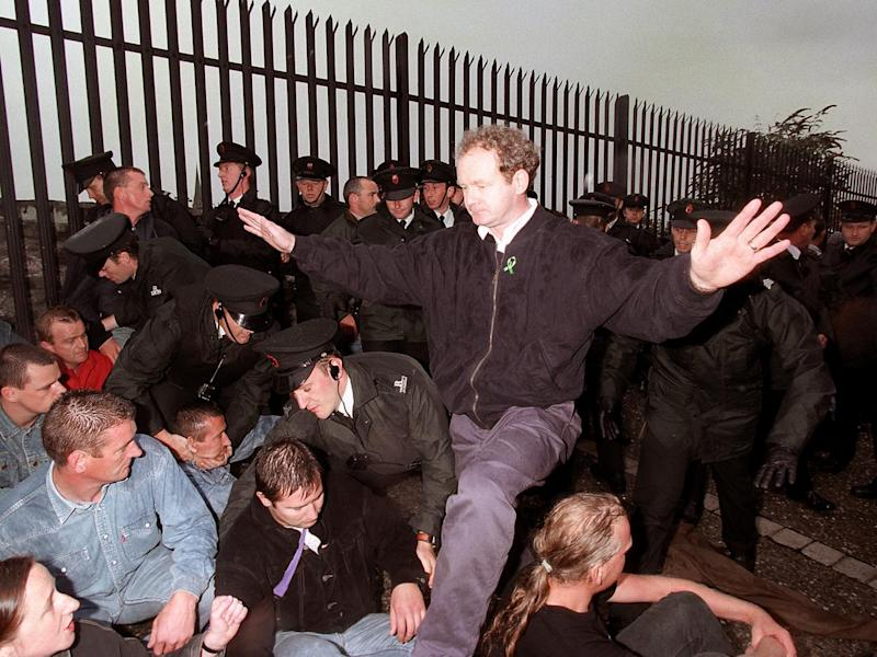 Sinn Fein's Martin McGuinness appeals to the Nationalists on the walls of Londonderry not to react violently to the RUC as the police moved them from the path of the Apprentice Boys march along Derry's walls (PA)