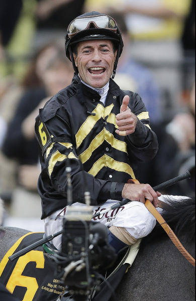 Jockey Gary Stevens gives thumbs up after riding Oxbow to win 138th Preakness Stakes horse race at Pimlico Race Course, Saturday, May 18, 2013, in Baltimore. (AP Photo/Matt Slocum)