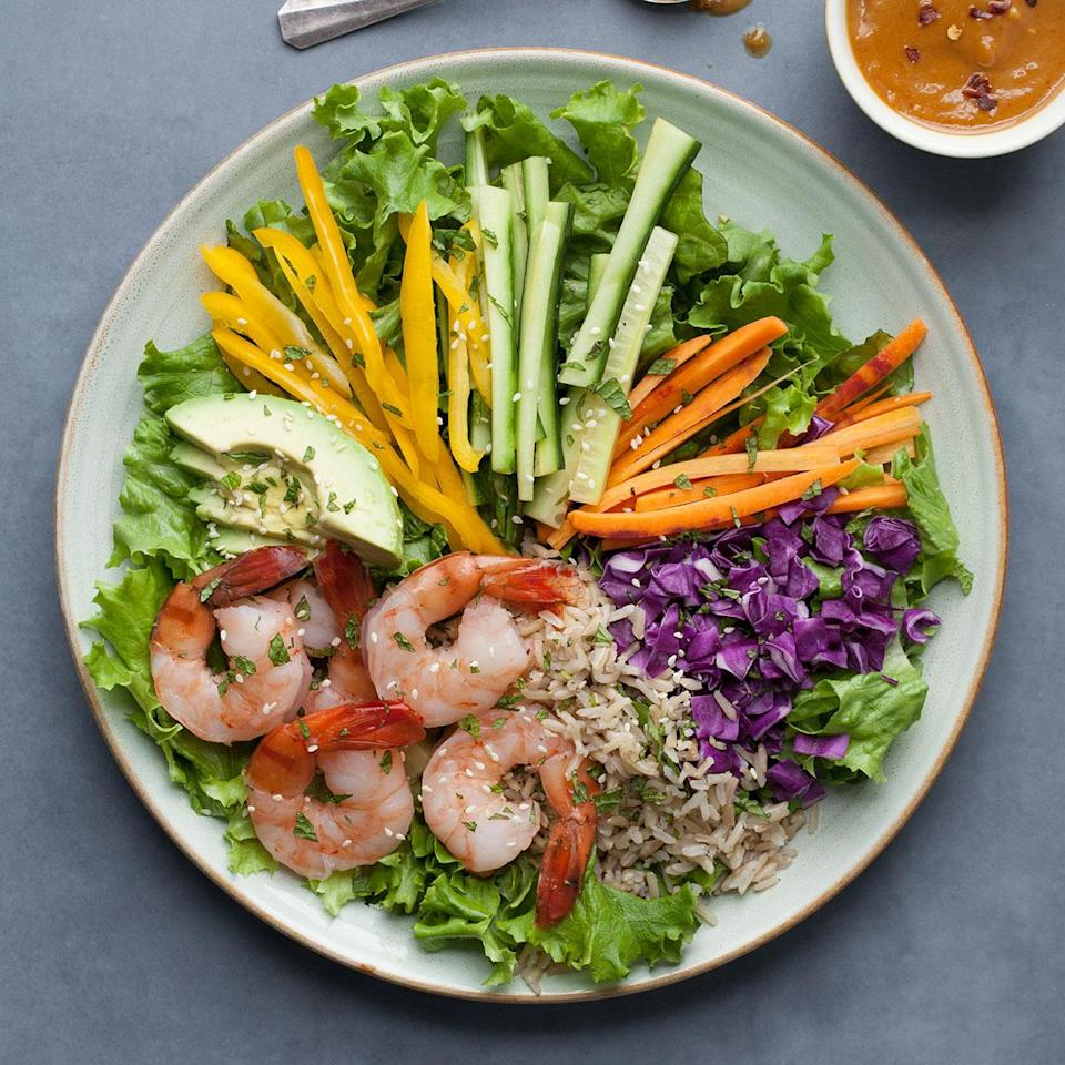 """<p>All the tastes, color and fun of a spring roll without all the work! This healthy salad recipe is bursting with the colors of rainbow from generous amounts of fresh vegetables, shrimp and whole grains all topped with a peanut dressing for the ultimate satisfying salad. <a href=""""http://www.eatingwell.com/recipe/256969/spring-roll-salad/"""" rel=""""nofollow noopener"""" target=""""_blank"""" data-ylk=""""slk:View recipe"""" class=""""link rapid-noclick-resp""""> View recipe </a></p>"""