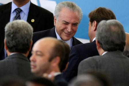 Brazil's President Michel Temer reacts during a ceremony to mark the signing of a decree on new regulations for beef inspection, at the Planalto Palace in Brasilia