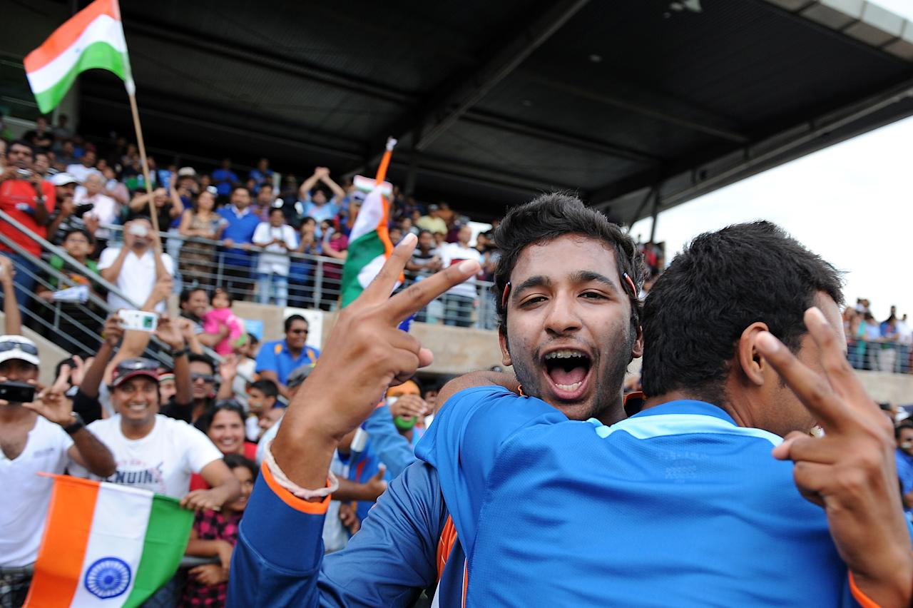 TOWNSVILLE, AUSTRALIA - AUGUST 26:  Vikas Mishra of India celebrates victory with supports after the 2012 ICC U19 Cricket World Cup Final between Australia and India at Tony Ireland Stadium on August 26, 2012 in Townsville, Australia.  (Photo by Matt Roberts/Getty Images)