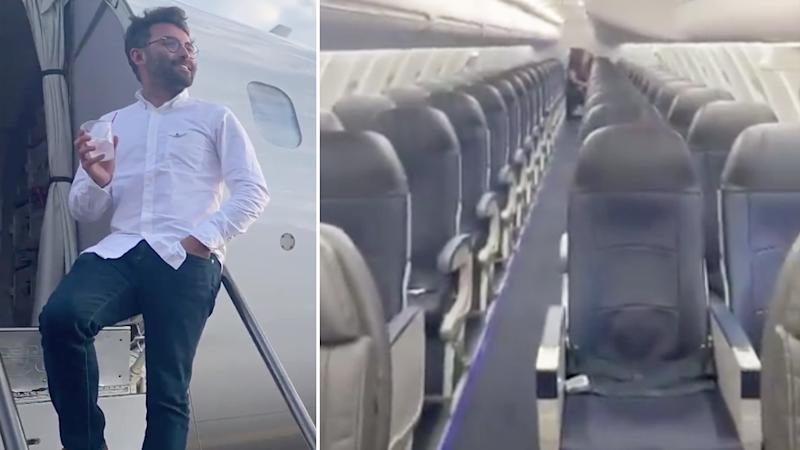 Vincent Peone poses on his empty flight where he was the only passenger.