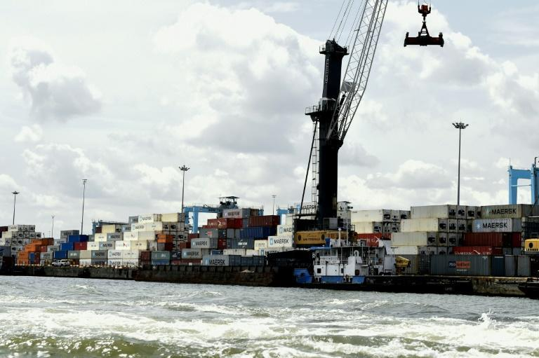 Shipping containers stacked at Lagos port. The spiralling costs of doing business at the port are handed on to the consumer
