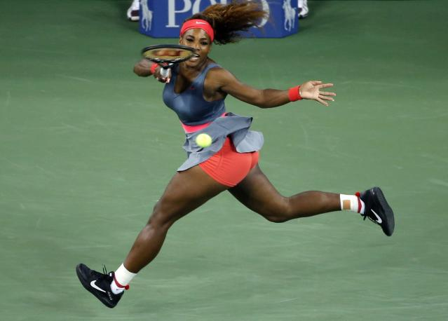 Serena Williams of the U.S. chases down a forehand to Carla Suarez Navarro of Spain at the U.S. Open tennis championships in New York September 3, 2013. REUTERS/Shannon Stapleton (UNITED STATES - Tags: SPORT TENNIS)