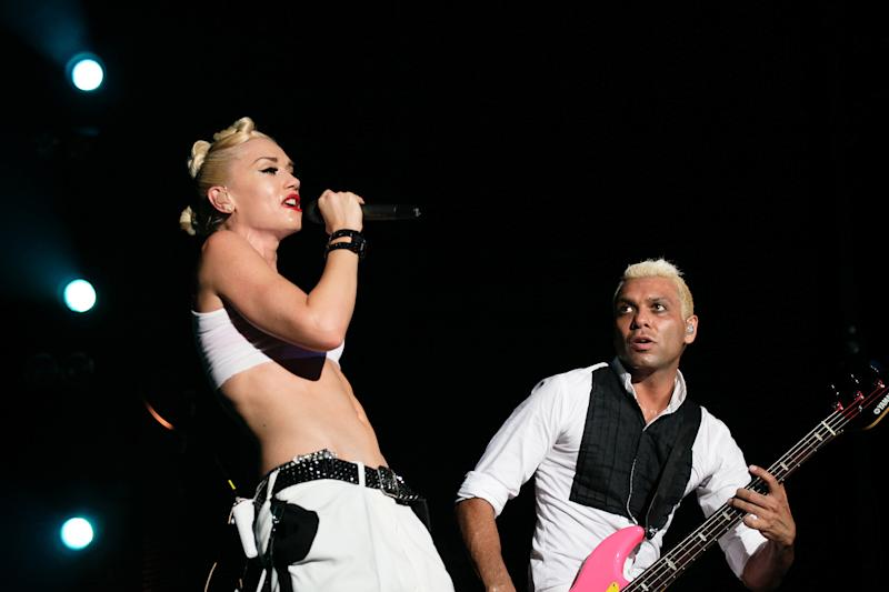 "FILE - In this Sept. 25, 2009 file photo, Gwen Stefani, left, and Tony Kanal from the U.S. band No Doubt perform at the F1 Rocks concert in Singapore. A Los Angeles judge ruled Tuesday, May 29, 2012, that the band No Doubt can argue to a jury that gaming giant Activision misused their images in the game ""Band Hero"" and breached a contract and may have committed fraud by failing to tell that players could use their characters to sing other artists' songs. (AP Photo/Joan Leong, file)"