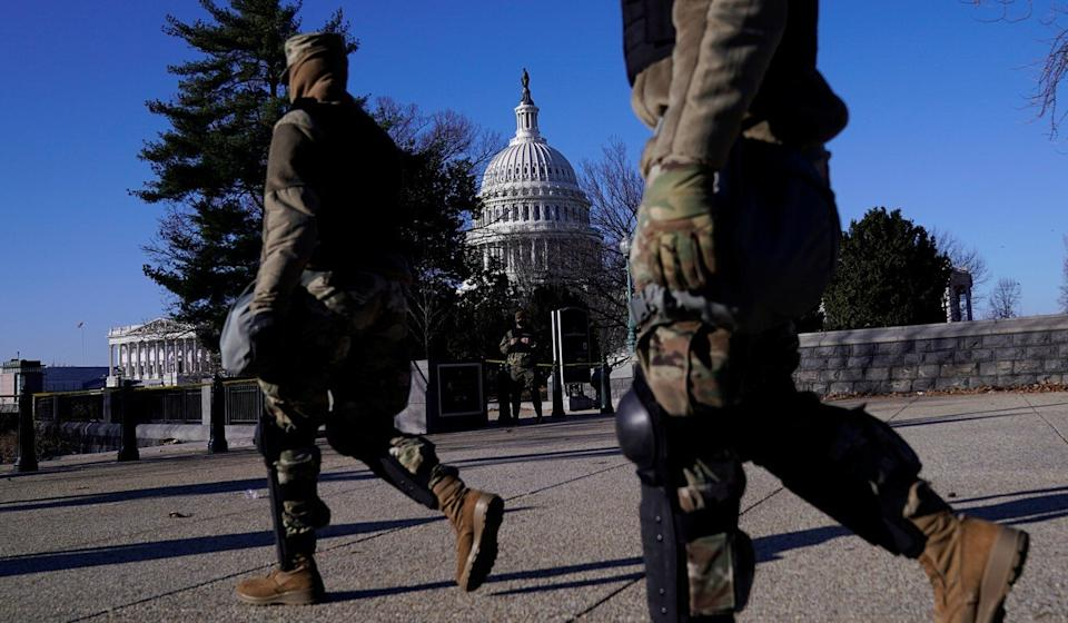 National Guard troops patrol the grounds of the US Capitol on Thursday. Photo: Reuters