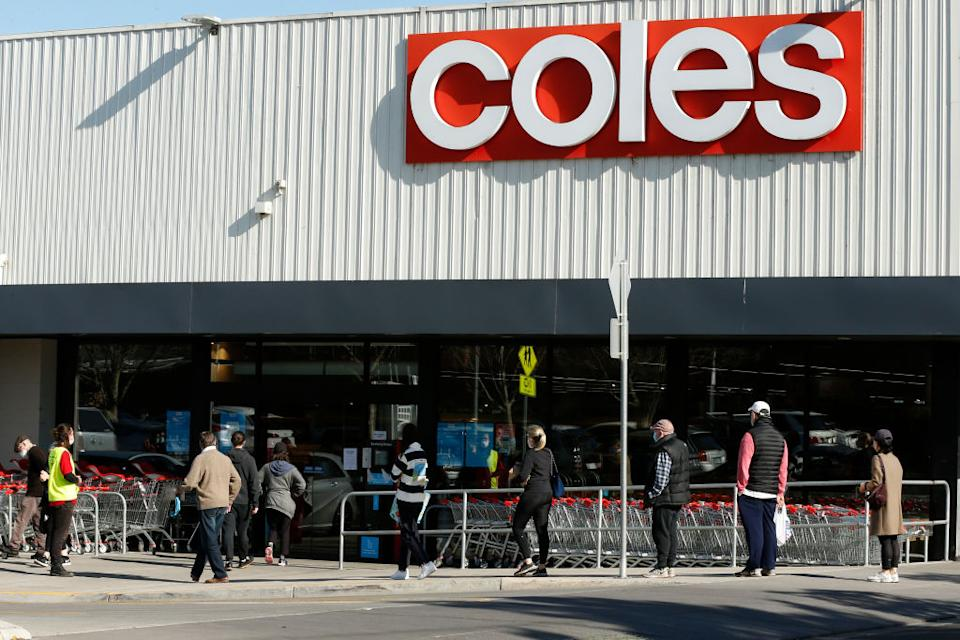 People line up outside a Coles supermarket in Malvern in Melbourne, Australia.