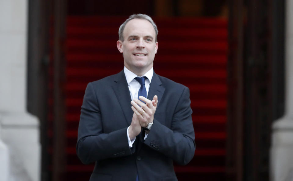 Foreign Secretary Dominic Raab clapping outside the Foreign and Commonwealth Office in London to salute local heroes during Thursday's nationwide Clap for Carers initiative to recognise and support NHS workers and carers fighting the coronavirus pandemic. PA Photo. Picture date: Thursday April 23, 2020. See PA story HEALTH Coronavirus. Photo credit should read: Frank Augstein/PA Wire