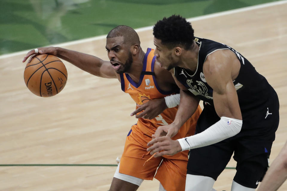 Phoenix Suns guard Chris Paul (3) drives to the basket against Milwaukee Bucks forward Giannis Antetokounmpo (34) during the first half of Game 6 of basketball's NBA Finals Tuesday, July 20, 2021, in Milwaukee. (AP Photo/Aaron Gash)