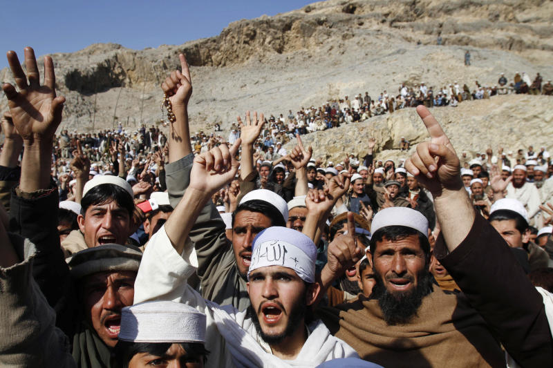 FILE - In this Feb. 24, 2012 file photo, Afghans shout anti-American slogans during an anti-U.S. protest in Ghani Khail, east of Kabul, Afghanistan over the burning of Qurans at a U.S. military base. Two U.S. troops were gunned down by an Afghan soldier and his accomplice Thursday, March 1, 2012, the latest of six American service members killed by their Afghan partners since the burning of Muslim holy books last week sent anti-Americanism soaring in a nation that has long distrusted foreigners. (AP Photo/Rahmat Gul, File)