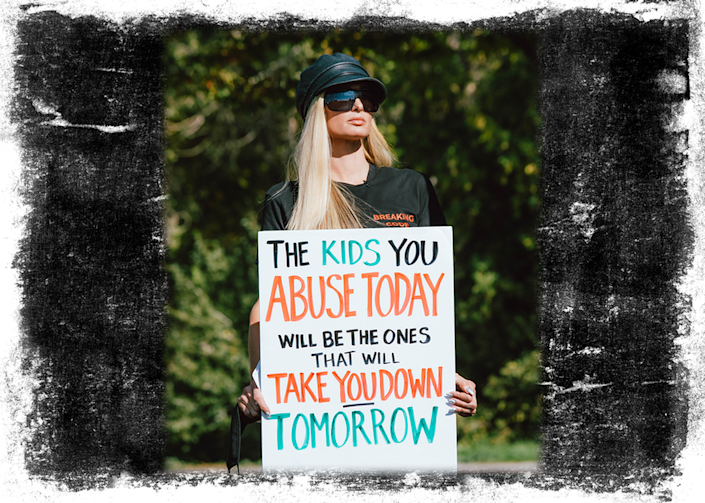 """Edit shows Paris Hilton holding a sign which says """"The kids you abuse today will be the ones that take you down tomorrow"""""""
