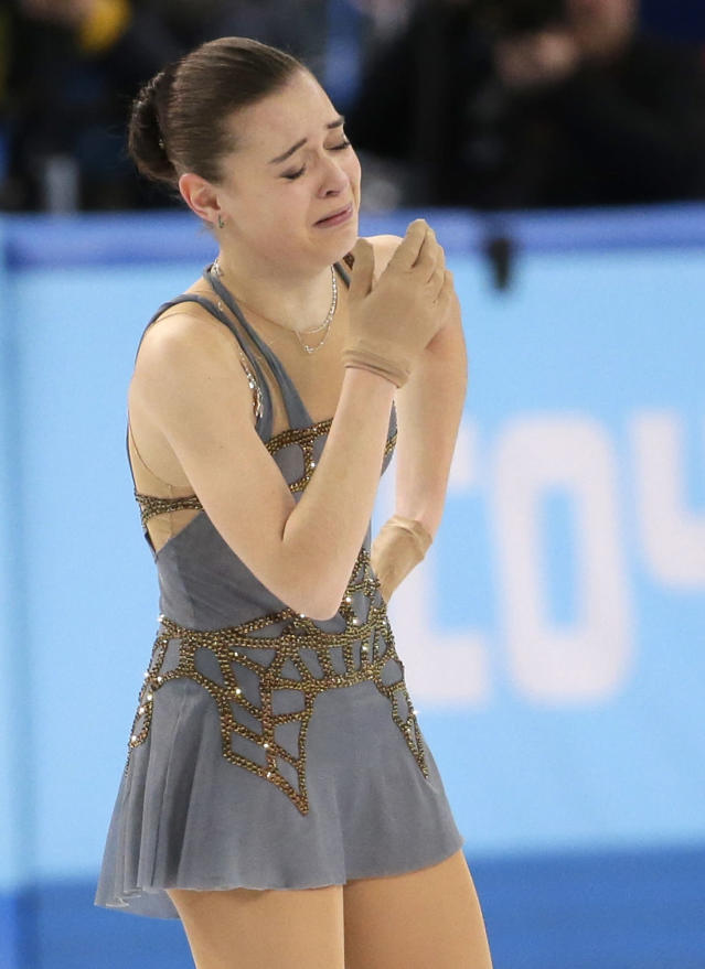 Adelina Sotnikova of Russia reacts after completing her routine in the women's free skate figure skating finals at the Iceberg Skating Palace during the 2014 Winter Olympics, Thursday, Feb. 20, 2014, in Sochi, Russia. (AP Photo/Bernat Armangue)