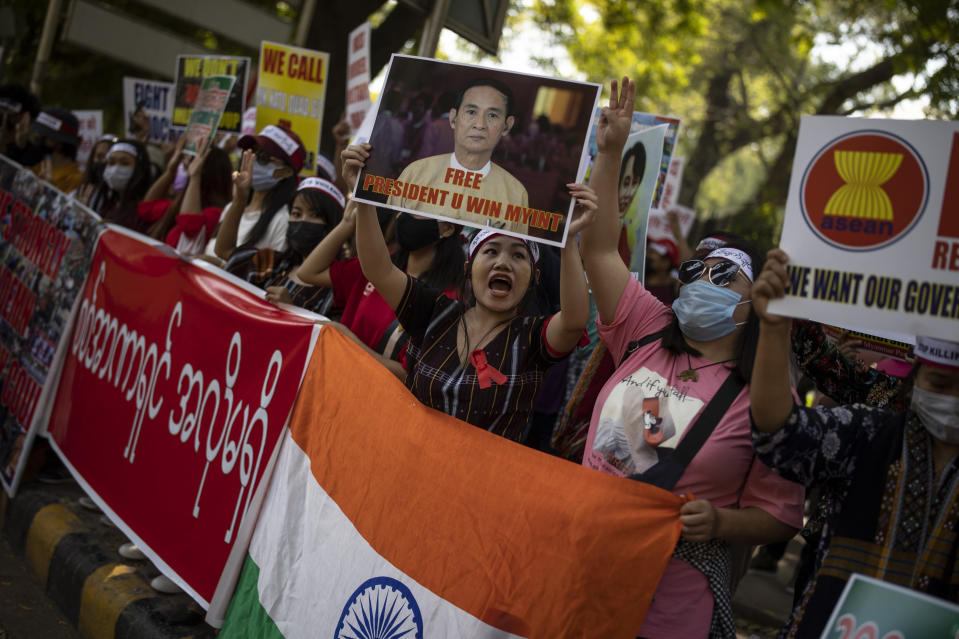Chin refugees from Myanmar shout slogans during a protest against military coup in Myanmar, in New Delhi, India, Wednesday, March 3, 2021. (AP Photo/Altaf Qadri)