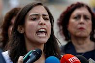 Patricia Ceballos, wife of jailed former mayor Daniel Ceballos, talks to the media outside a detention center of the Bolivarian National Intelligence Service (SEBIN), where a riot occurred, according to relatives, in Caracas, Venezuela May 16, 2018. REUTERS/Carlos Garcia Rawlins