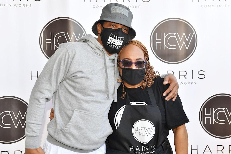 <p>T.I. poses with his mom, Violeta Morgan, on Tuesday at the Harris Community Works 15th Annual Turkey Giveaway at Jackson Memorial Baptist Church in Atlanta.</p>