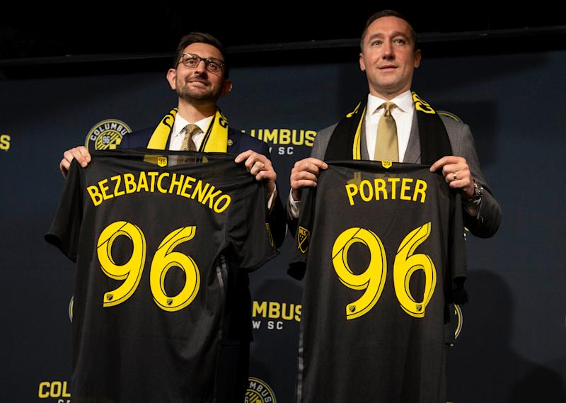 Jan 9, 2019; Columbus, OH, USA; New Columbus Crew SC general manager Tim Bezbatchenko and head coach Caleb Porter stand during an introductory press conference at The Ivory Room. Mandatory Credit: Greg Bartram-USA TODAY Sports/Sipa USA