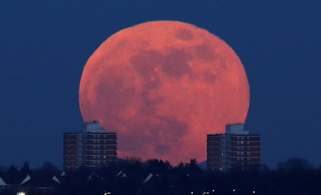 <p>A full moon rises behind blocks of flats in north London, Britain, Jan. 31, 2018. (Photo: Eddie Keogh/Reuters) </p>
