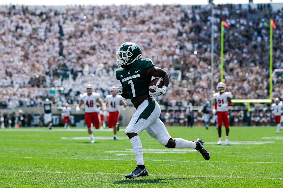 Michigan State wide receiver Jayden Reed (1) scores a touchdown against Youngstown State during the first half at Spartan Stadium in East Lansing on Saturday, Sept. 11, 2021.
