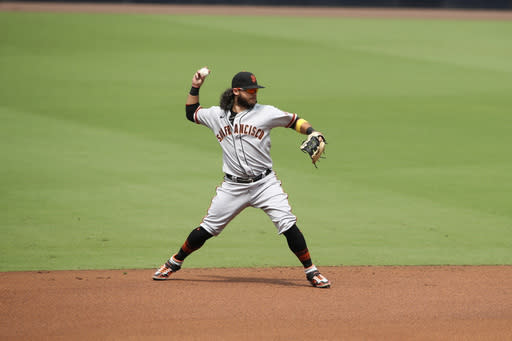 San Francisco Giants shortstop Brandon Crawford throws out San Diego Padres Fernando Tatis Jr., on a ground ball in the first inning of a baseball game Sunday, Sept. 13, 2020, in San Diego. (AP Photo/Derrick Tuskan)