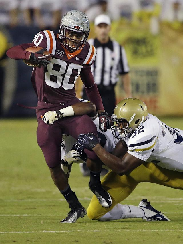 Virginia Tech wide receiver Demitri Knowles (80) is stopped by Georgia Tech linebacker Paul Davis (40) and linebacker Jabari Hunt-Days (32) in the first half of an NCAA college football game on Thursday, Sept. 26, 2013 in Atlanta. (AP Photo/John Bazemore)