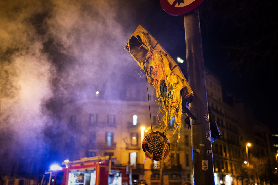 A damaged traffic light, following clashes between demonstrators and police after a protest condemning the arrest of rap singer Pablo Hasél in Barcelona, Spain, Thursday, Feb. 18, 2021. Protests over the imprisonment of a rapper convicted for insulting the Spanish monarchy and praising terrorist violence have morphed for the third night in a row into rioting. Pablo Hasél began this week to serve a 9-month sentence in a northeastern prison. (AP Photo/Emilio Morenatti)