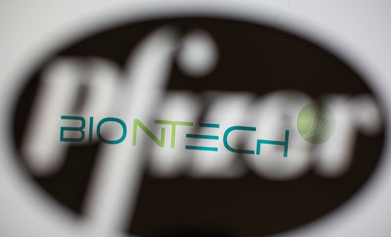 Biontech's logo is seen through a 3D-printed Pfizer logo in this illustration