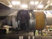 This photo provided by The National Transportation Safety Board shows the damaged engine of United Airlines Flight 328. Federal safety officials are updating their investigation into the engine failure on the United Airlines plane that sent parts of the engine housing raining down on Denver-area neighborhoods last month. The National Transportation Safety Board said Friday, March 5, 2021 that a microscopic exam confirmed that a fan blade that snapped off had telltale signs of fatigue — tiny cracks caused by wear and tear. (The National Transportation Safety Board via AP)