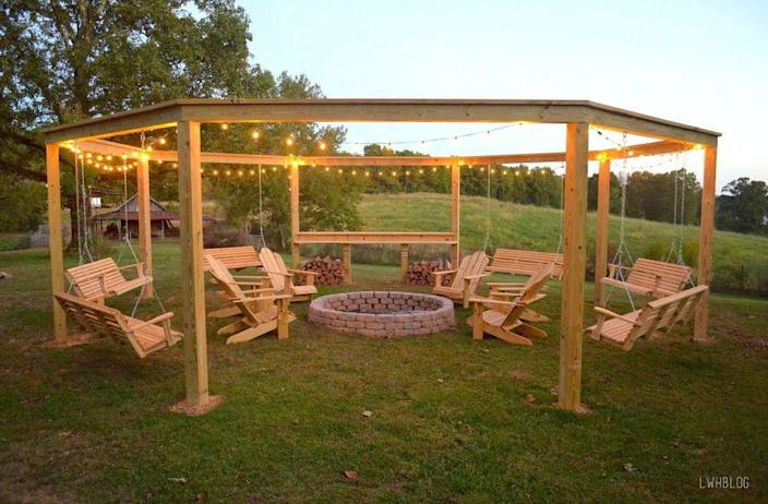 """<p>Outdoor string lights are the finishing touch on this amazing DIY pergola and fire pit setup.</p><p><strong><a href=""""https://www.countryliving.com/diy-crafts/g31966151/outdoor-fireplace-ideas/"""" rel=""""nofollow noopener"""" target=""""_blank"""" data-ylk=""""slk:See more here."""" class=""""link rapid-noclick-resp"""">See more here.</a></strong></p><p><a class=""""link rapid-noclick-resp"""" href=""""https://www.amazon.com/Brightech-Ambience-Pro-Waterproof-Outdoor/dp/B01JRL963Y?tag=syn-yahoo-20&ascsubtag=%5Bartid%7C10050.g.3404%5Bsrc%7Cyahoo-us"""" rel=""""nofollow noopener"""" target=""""_blank"""" data-ylk=""""slk:SHOP STRING LIGHTS"""">SHOP STRING LIGHTS</a></p>"""