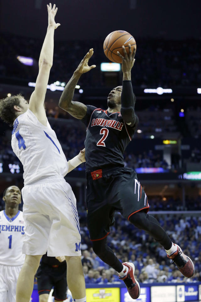 Louisville's Russ Smith (2) goes to the basket in front of Memphis' Austin Nichols (4) in the first half of an NCAA college basketball game in Memphis, Tenn., Saturday, March 1, 2014. (AP Photo/Danny Johnston)