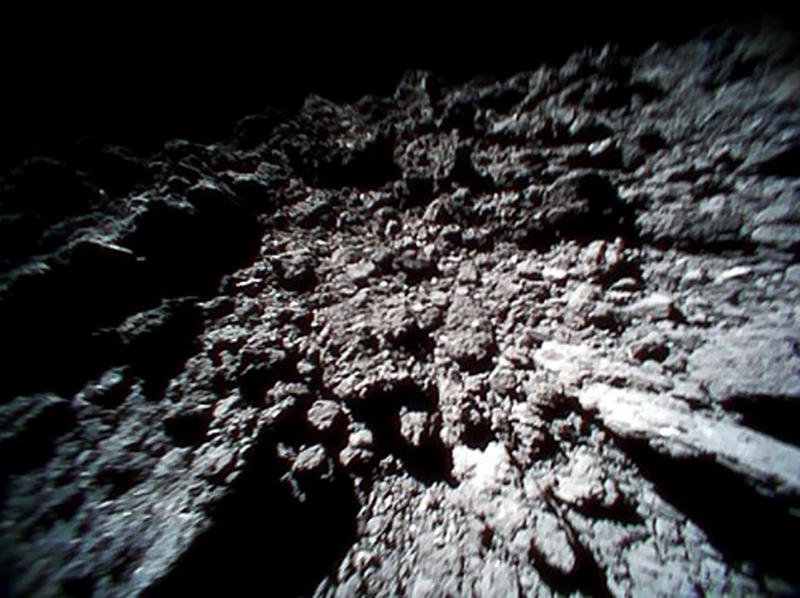 FILE - This Sept. 23, 2018 file image captured by Rover-1B, and provided by the Japan Aerospace Exploration Agency (JAXA) shows the surface of asteroid Ryugu. Japan's space agency is delaying a spacecraft touchdown on an asteroid as scientists need more time to find a safe landing site on the extremely rocky surface. (JAXA via AP, File)