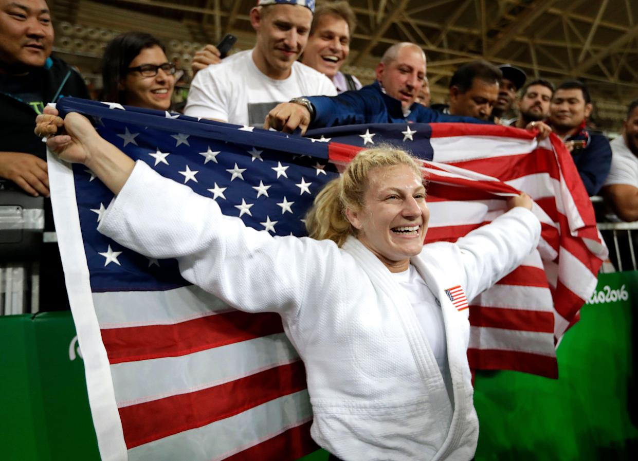 FILE - In this Thursday, Aug. 11, 2016 file photo, United States' Kayla Harrison celebrates after defeating France's Audrey Tcheumeo in the women's 78-kg judo gold medal match at the 2016 Summer Olympics in Rio de Janeiro, Brazil. (AP Photo/Jae C. Hong, File)