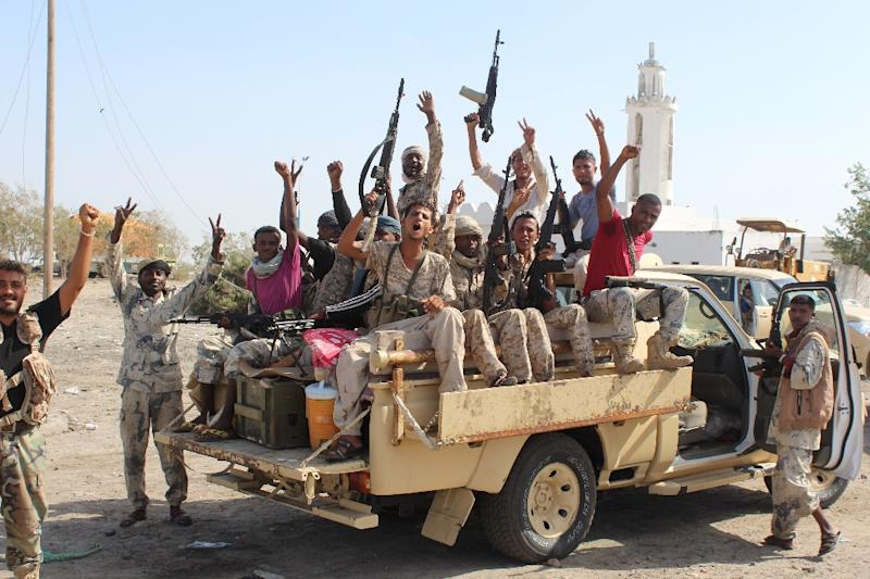 Forces loyal to the Saudi-backed Yemeni president cheer on a road in Abyan province as they take part in an operation to drive Al-Qaeda fighters out of the southern provincial capital, on April 23, 2016