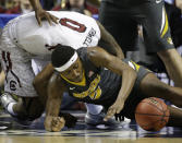 Missouri forward D'Angelo Allen (5) vies for a loose ball against South Carolina guard Sindarius Thornwell (0) during the second half of an NCAA college basketball game in the first round of the Southeastern Conference tournament, Wednesday, March 11, 2015, in Nashville, Tenn. (AP Photo/Mark Humphrey)