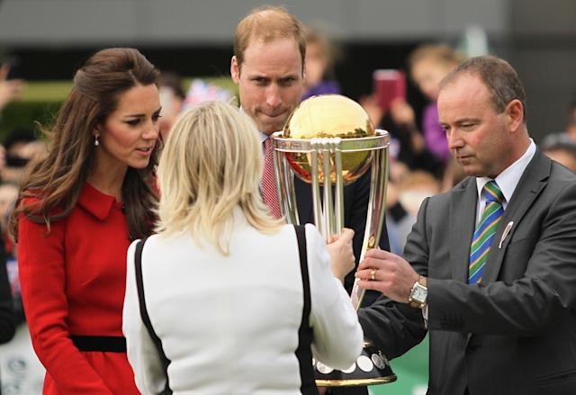 CHRISTCHURCH, NEW ZEALAND - APRIL 14: Therese Walsh, Head of New Zealand ICC Cricket World Cup 2015, (Front L) and Lee Germon, CEO of Canterbury Cricket present the ICC Cricket World Cup Trophy to Catherine, Duchess of Cambridge and Prince William, Duke of Cambridge, for a hold during the countdown to the 2015 ICC Cricket World Cup at Hagley Oval on April 14, 2014 in Christchurch, New Zealand. The Royal couple are currently in New Zealand and touring the country until Wednesday, when they then head to Australia. Today the Royals visit the redevelopments at Hagley Oval, the venue for ICC Cricket World Cup 2015 matches in Christchurch. (Photo by Joseph Johnson/Getty Images for ICC Cricket World Cup)