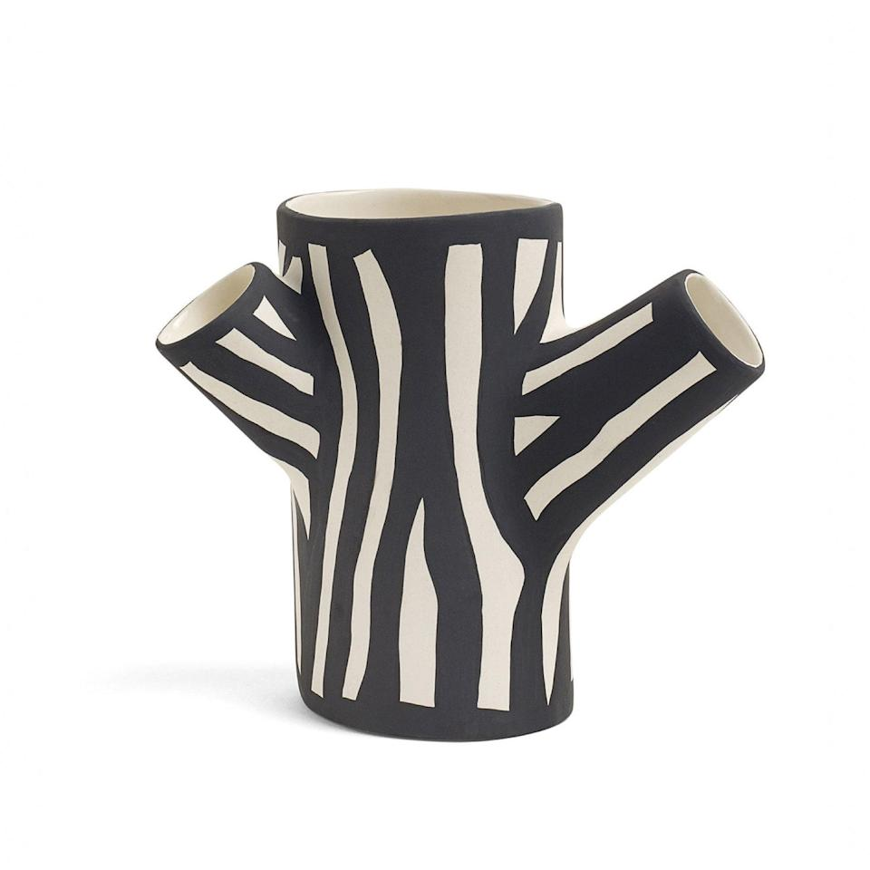 """This stoneware ceramic design is hand-pained a statement zebra print and sculpted to look like a tree trunk, but the arms are giving cactus vibes. $65, Neiman Marcus. <a href=""""https://www.neimanmarcus.com/p/hay-small-zebra-print-tree-trunk-vase-prod223320167"""" rel=""""nofollow noopener"""" target=""""_blank"""" data-ylk=""""slk:Get it now!"""" class=""""link rapid-noclick-resp"""">Get it now!</a>"""
