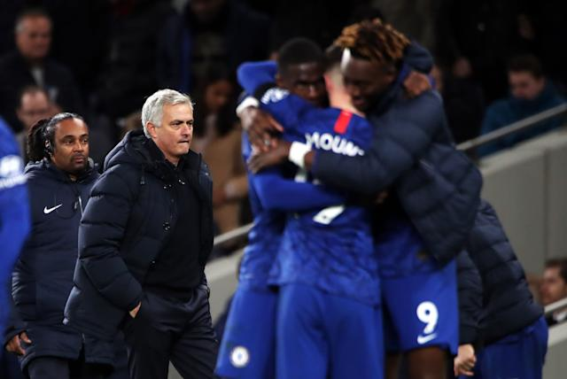 Chelsea players celebrate victory as Tottenham Hotspur manager Jose Mourinho looks on during the Premier League match at Tottenham Hotspur Stadium, London. (Photo: PA Wire/PA Images)
