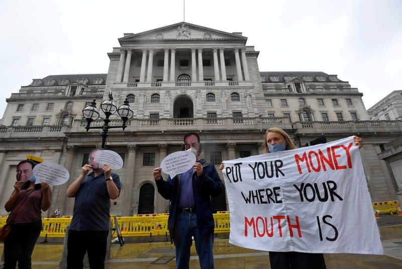 FILE PHOTO: Environmental protest to encourage a green economy, outside of the Bank of England in the City of London, Britain