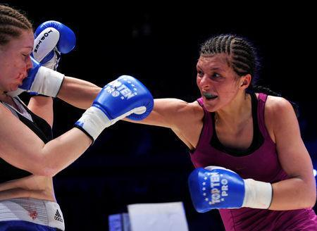 FILE PHOTO: Christina Hammer of Germany (R) punches Diana Kiss of Hungary at the WBF World Championship Middleweight title fight in Ljubljana February 18, 2011. REUTERS/Srdjan Zivulovic/File Photo