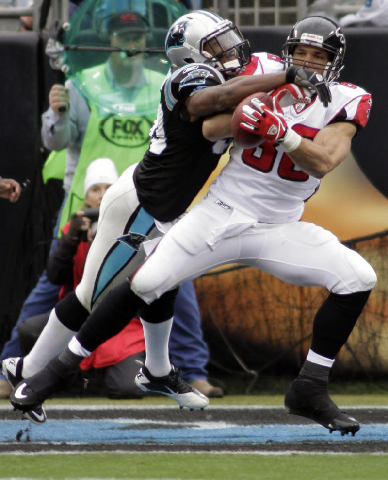 Atlanta Falcons' Tony Gonzalez, right, catches a touchdown pass as Carolina Panthers' James Anderson, left, defends during the first half of an NFL football game in Charlotte, N.C., Sunday, Dec. 12, 2010. (AP Photo/Rick Havner)