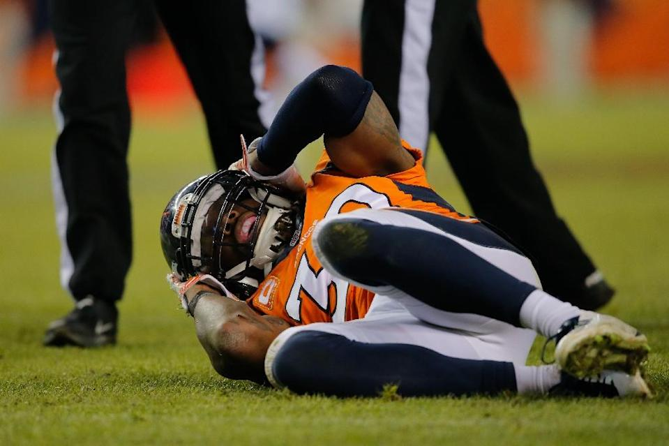 Strong safety David Bruton of the Denver Broncos lies on the ground after a play that would force him out of the game with a reported concussion during a game against the Oakland Raiders (AFP Photo/Doug Pensinger)