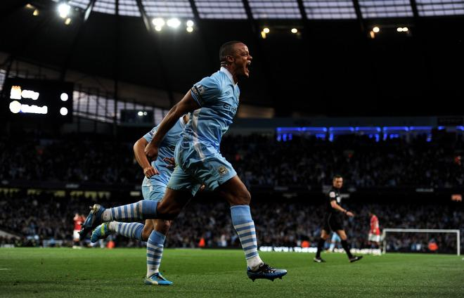 MANCHESTER, ENGLAND - APRIL 30:  Vincent Kompany of Manchester City celebrates scoring the opening goal during the Barclays Premier League match between Manchester City and Manchester United at the Etihad Stadium on April 30, 2012 in Manchester, England.  (Photo by Michael Regan/Getty Images)