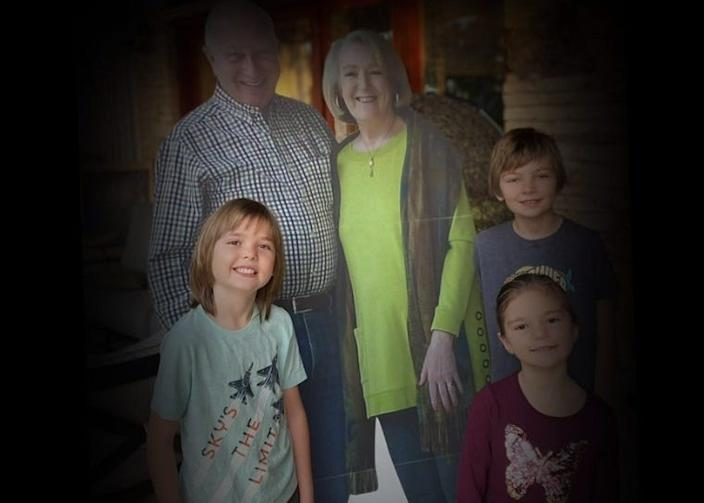 Missy and Barry Buchanan's grandchildren pose with the cardboard cutout their grandparents sent in lieu of traveling for Thanksgiving.