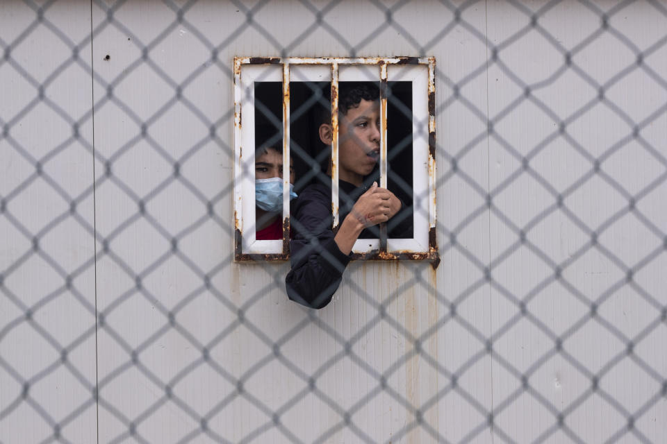 Children who crossed into Spain wait inside a temporary shelter for unaccompanied minors in the enclave of Ceuta, next to the border of Morocco and Spain, Thursday, May 20, 2021. (AP Photo/Bernat Armangue)