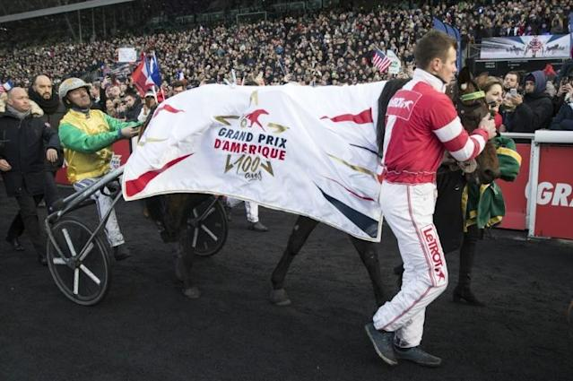 Bjorn Goop and Face Time Bourbon in front of the Vincennes Hippodrome crowds in Paris (AFP Photo/THOMAS SAMSON)