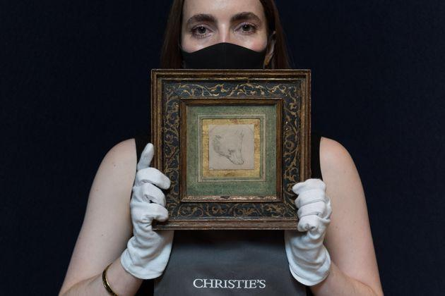 LONDON, UNITED KINGDOM - JULY 05, 2021: A staff member holds a drawing titled 'Head of a Bear' by Leonardo da Vinci (1452-1519), estimate: £8,000,000 - 12,000,000 during a photo call for Classic Week at Christie's auction house, a marquee series of nine auctions which feature works of art from antiquity to the 20th century  on July 05, 2021 in London, England. (Photo credit should read Wiktor Szymanowicz/Barcroft Media via Getty Images) (Photo: Barcroft Media via Getty Images)