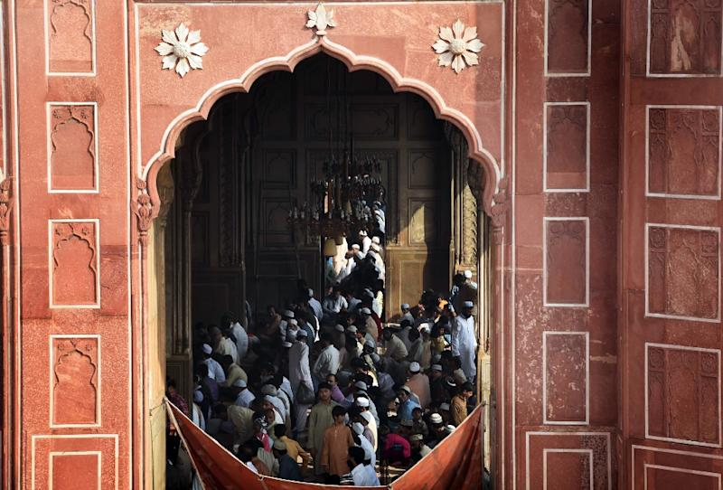 Pakistani Muslims pray in Lahore in September