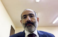 This fame grab taken from a video published on Armenian Prime Minister Nikol Pashinyan FaceBook official account @nikol.pashinyan, showing Armenian Prime Minister Nikol Pashinyan addressing the nation in unknown location in Armenia, Tuesday, Nov. 10, 2020. Armenia and Azerbaijan announced an agreement early Tuesday to halt fighting over the Nagorno-Karabakh region of Azerbaijan under a pact signed with Russia that calls for deployment of nearly 2,000 Russian peacekeepers and territorial concessions. (@nikol.pashinyan, Armenian Prime Minister official Facebook account via AP)