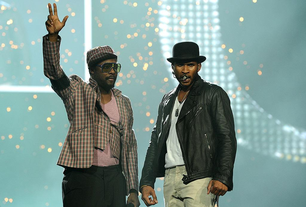 """Joined by the Black Eyed Peas' Will.i.am, Usher opened the show with four songs including his hits """"Yeah"""" and """"OMG."""" Michael Buckner/<a href=""""http://www.gettyimages.com/"""" target=""""new"""">GettyImages.com</a> - June 14, 2010"""