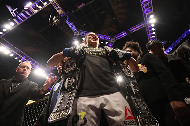 Amanda Nunes holds the belts for UFC's women's bantamweight and featherweight divisions, with two wins over the current women's flyweight champion as well. (Getty Images)